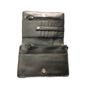 Black leather interior has many slots for cards as well as small pocket spaces