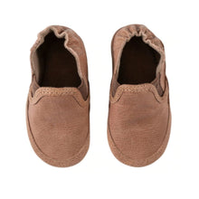 Load image into Gallery viewer, Looking down on a pair of simple brown soft kids easy on shoes with elastic side panels