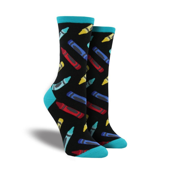 Black socks with blue accents and crayons on it