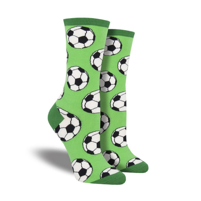 Green socks with soccer balls on them
