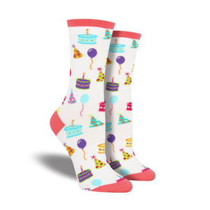 A pair of women's crew socks featuring birthda y hats.