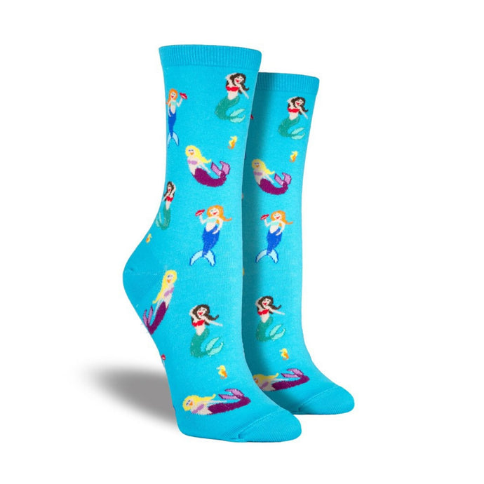 Bright blue socks with mermaids swimming on them