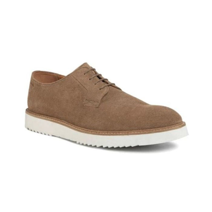 Dark sand suede Ernest walking shoe by Clarks with a thick white sole and laces.