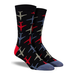 A pair of black socks with blue, red and grey airplanes on them. Made by Socksmith.