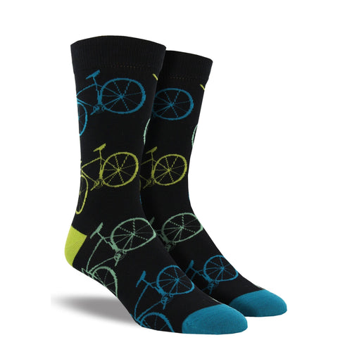 A pair of men's black crew socks with blue and lime bikes on them.