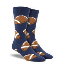 Load image into Gallery viewer, A pair of men's blue crew socks with footballs on them.