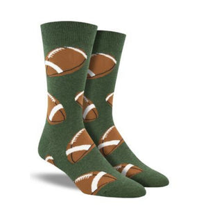 A pair of men's green crew socks with footballs on them.