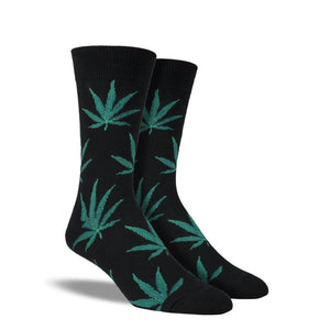 A pair of men's black crew socks with pot leaves on them.