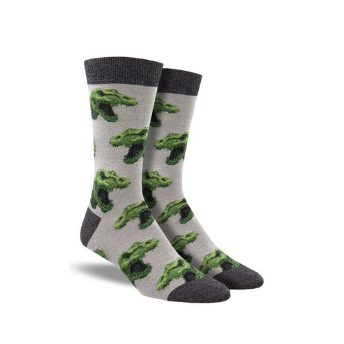 Grey socks with dark grey accents and T-rex heads on it