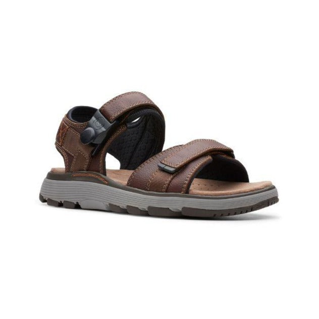 Dark tan Untrek sandal by Clarks has two magnetic closure cross foot straps and an ankle strap and grey outsole