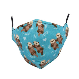 Blue face mask with otters swimming in pairs