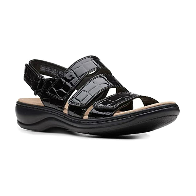 Black crocodile texture leather Melinda sandal by Clarks has 3 wide over the foot straps and a velcro back strap with a small platform heel