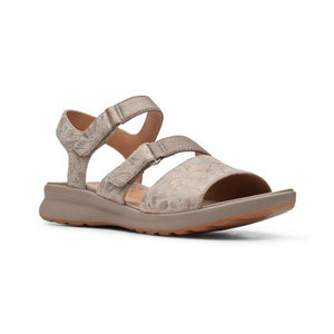 An Ease sandal by Clarks that has a taupe metallic patterned sandal with a thick strap over toe, thin Velcro strap across foot and around ankle.