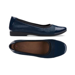 Side view of navy Darcey Cap flat by Clarks has textured side with black nubuck trim and a top view showing tan footbed and shiny navy toe