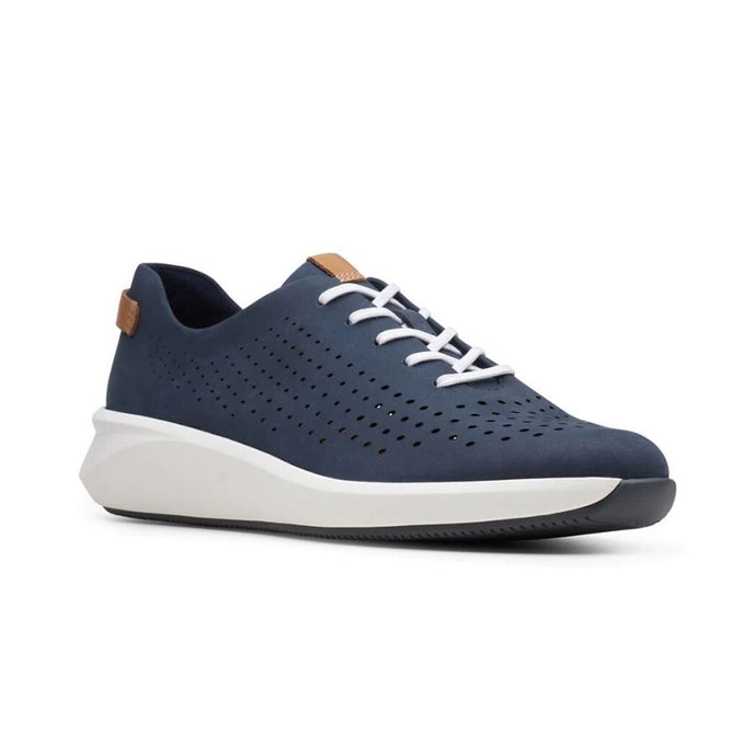 The Rio Tie sneaker by Clarks has soft navy leather with dotted line perforations and white laces with a white and black outsole.