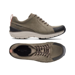 Side view shows thick outsole and decorative lines in the taupe and black upper while top view shows black footbed and oxford style lacing and black trim around toe on the Wave go sneakers by Clarks