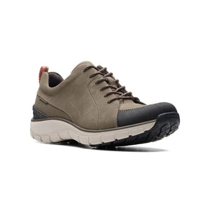 High top sneakers with hiker style has black sections and thick white and black tread on the Wave go taupe sneaker by Clarks