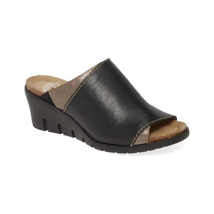 Slip on sandal with black upper and peak-a-boo style brown accents with slight black wedge