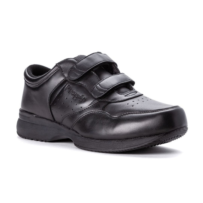 Black leather sneakers wit 2 velcro straps, perforated sections and thick outsole