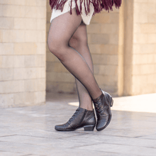 Load image into Gallery viewer, Women wearing a laced ankle bootie in wine multi leather with la eaf detail.