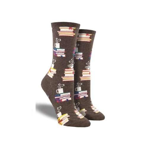 Brown socks with stacks of books and coffee mug at top