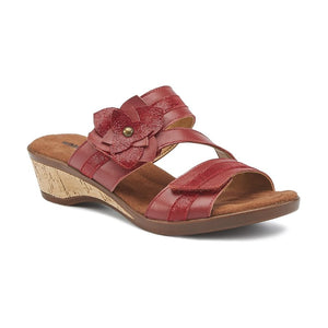 The Kimmy sandal by Walking Cradles has a cork heel and has two red thick straps in red with a cross strap over foot to meet at a big red flower