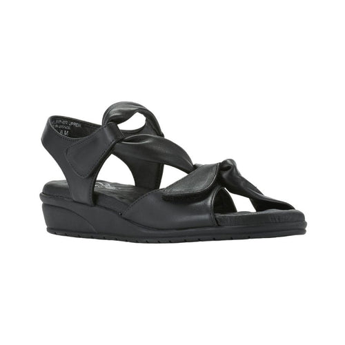 The Valerie sandal by Walking Cradles has looped around black leather straps with Velcro closure and a small platform heel