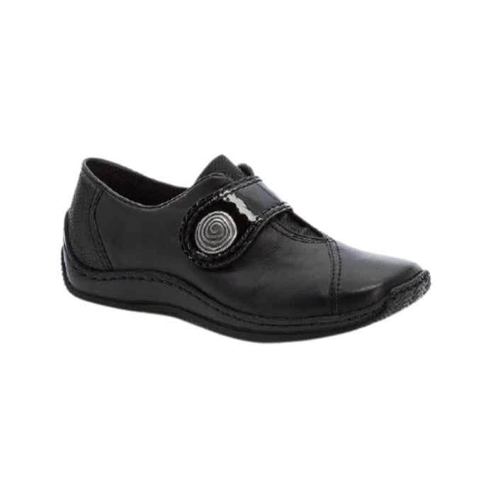 Black slip on shoe with oversize across foot flap with circle design closure
