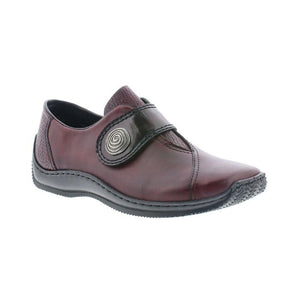 Red slip on shoe with oversize across foot flap with circle design closure