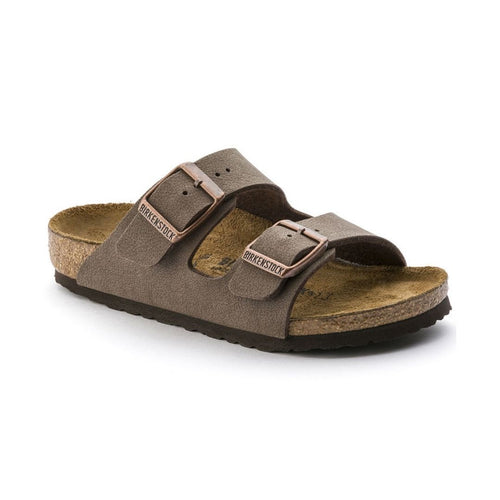 Side view of a youth Birkenstock light brown slip on two strap sandal with supportive cork footbed.