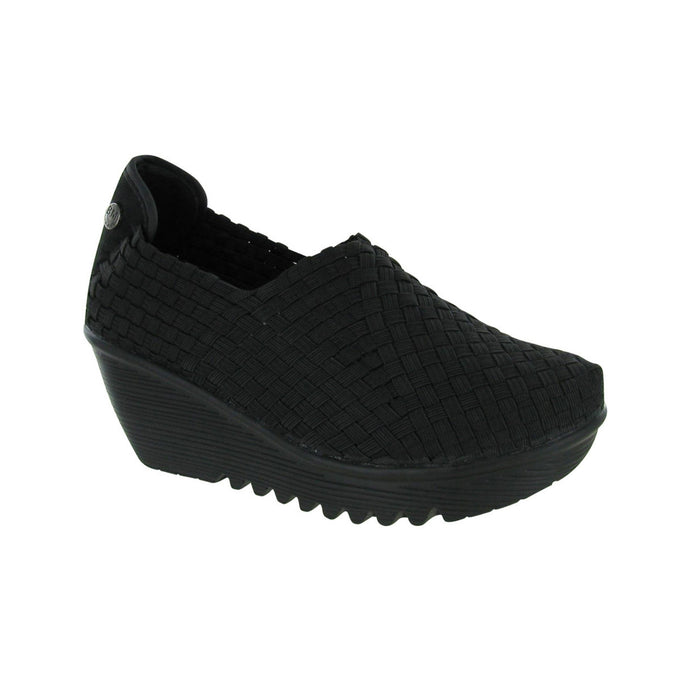 Thick black wedge with expandable woven uppers in black and jagged outsole tread