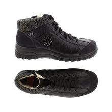 Load image into Gallery viewer, Top and side view has warm lining on  Black lace up ankle boot by Rieker with knit trim and black circle accent on side with dots.