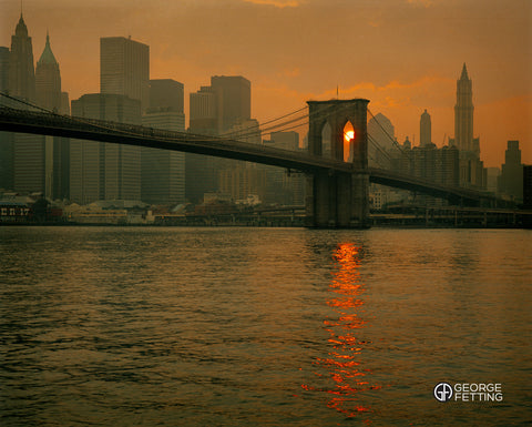 Iconic NY vista twilight, view of Brooklyn Bridge with Manhattan behind