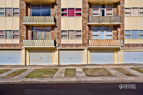 Geometric lines of an ageing Sydney unit block complete with doll