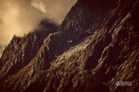 Awesome scale of Milford Sound is revealed by the miniscule passing plane