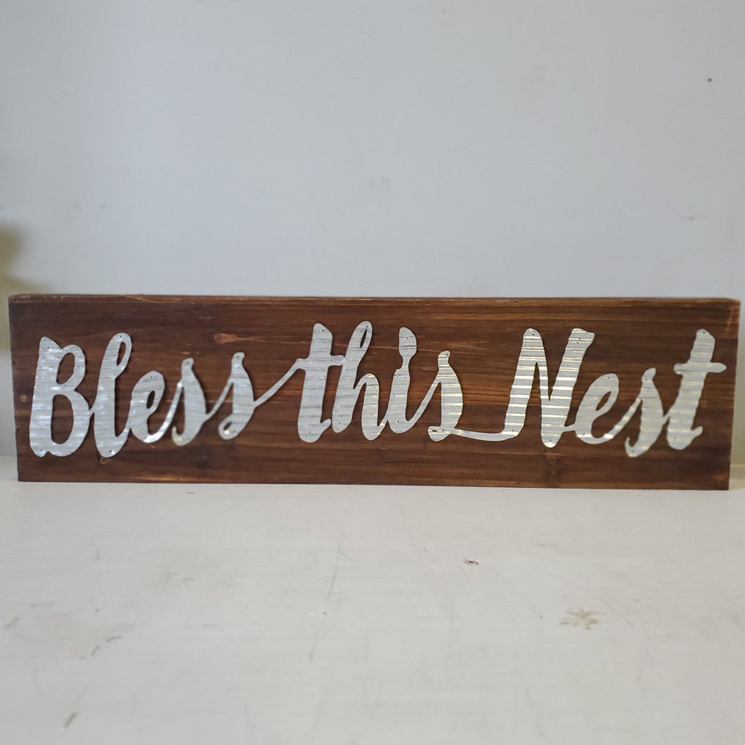 'Bless this Nest' sign