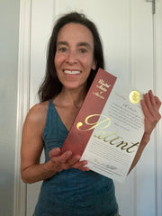 Patented Inventor Cyndi Bray holds her issued patent for Wad-Free