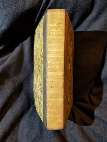 Requiem for a Nun by William Faulkner. First edition. Number 119 of 750 copies signed by Faulkner.