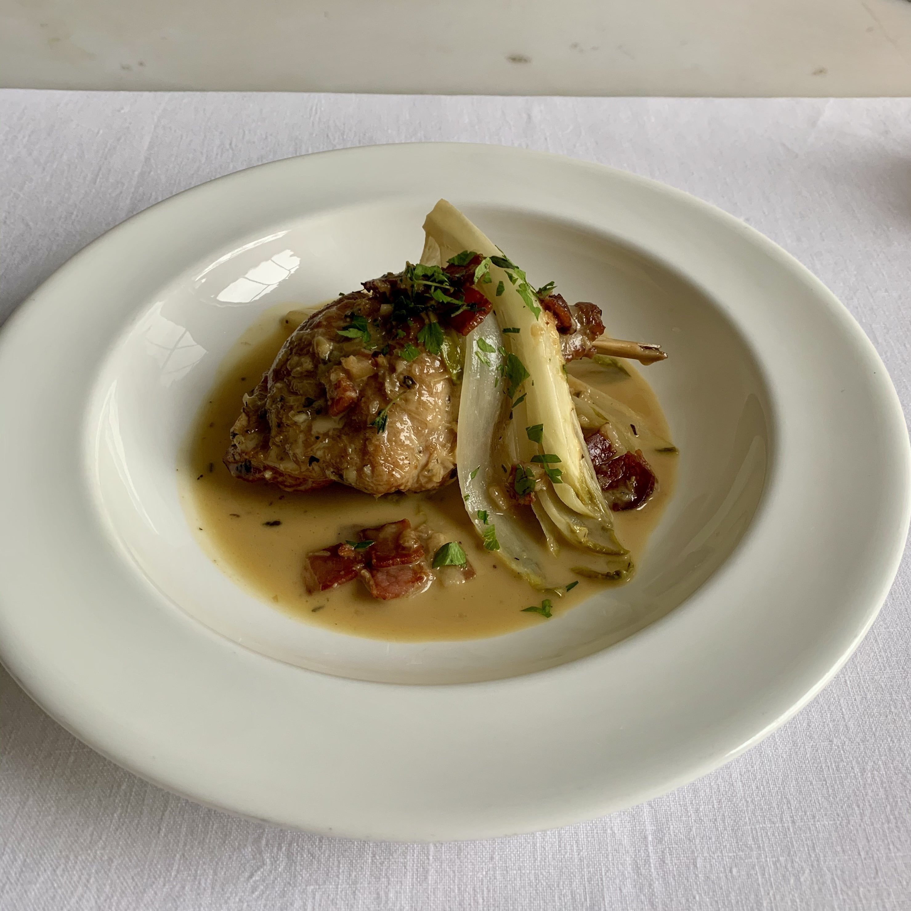 Braised Rabbit with Chicory, Pancetta, Verjus and Creme Fraiche