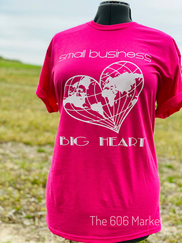 hot pink t-shirt with small business big heart on front  and a heart shape globe printed on front of t-shirt