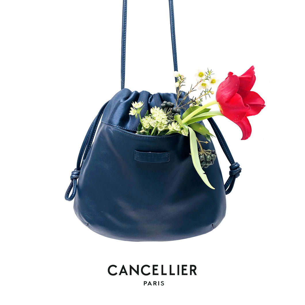 CHLORIS BLUE, réversible bag in blue nappa leather and navy and blue striped satin