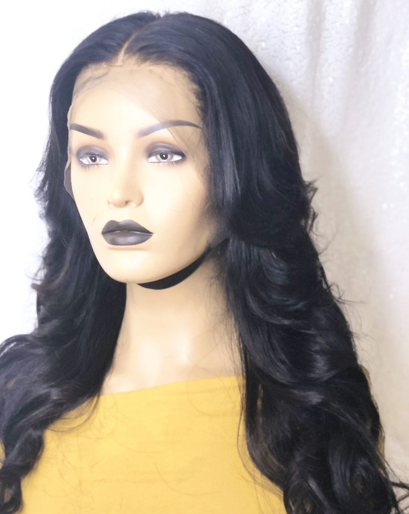 We sell high quality lace frontal wigs that are hand-tied and fully customized to be worn right away. This wig comes with a middle part with medium to long layers. The color is off black and can be bleached to a different color.