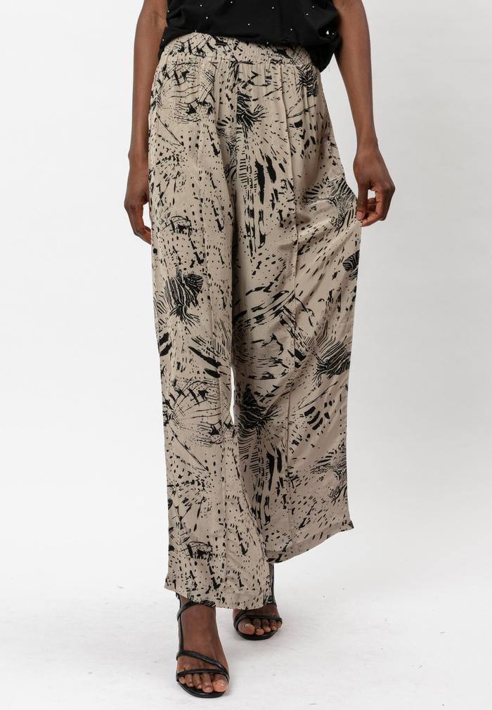 Roots Trousers in Taupe by Religion