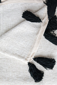WHITE RAW COTTON THROW WITH BLACK TASSELS