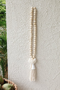 WOOD AND SHELL TASSEL DECOR