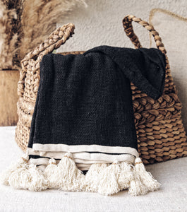 BLACK RAW COTTON THROW WITH NATURAL TASSELS