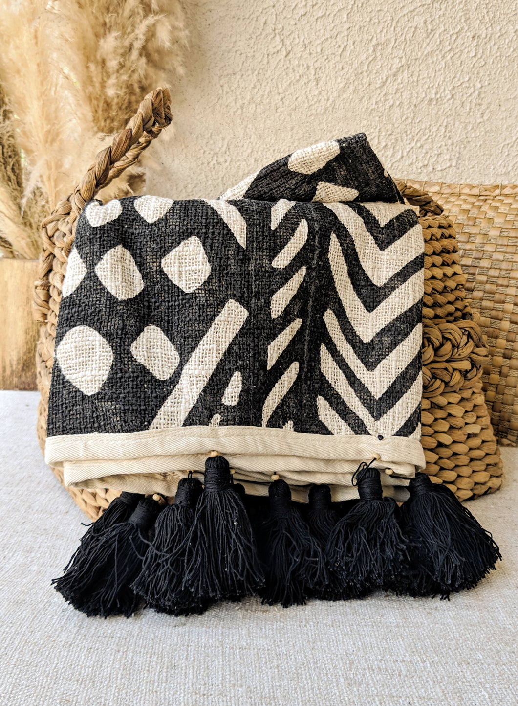 RAW COTTON TRIBAL PATTERN THROW WITH BLACK TASSELS