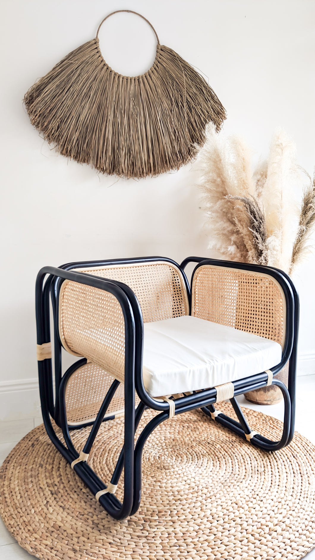 BLACK CANE AND RATTAN LOUNGER