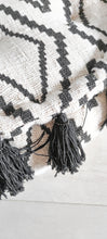 Load image into Gallery viewer, AZTEC PATTERN AND BLACK TASSEL POUFF