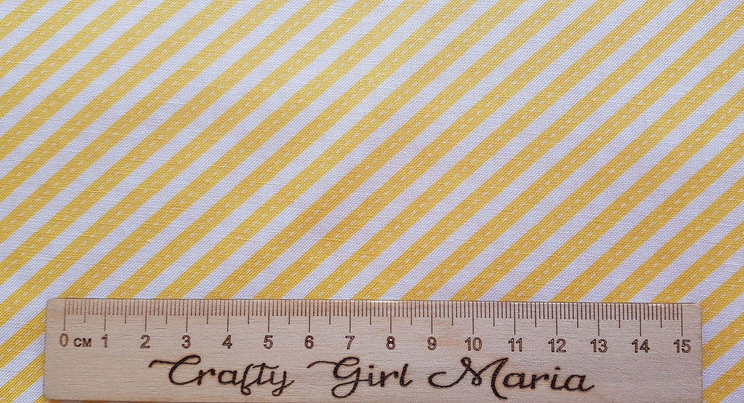 Yellow Ribbons Diagonal Stripe: Singing in the Rain cotton fabric: by the fat quarter. Riley Blake.